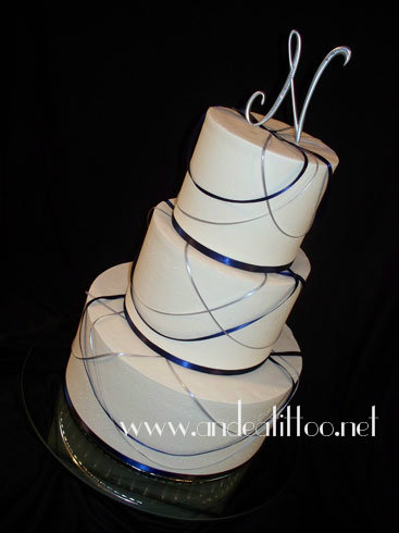 """All Tied Up 6"" This is a 12"" chocolate rush cake and an 8"" & 6"" almond cake. The 8"" is filled with red raspberry, and the 6"" with cinnamon butter cream. Creme de cacao butter cream over all and the filling in the 12"" tier. The ribbon is real. Served 92. The reception was held in the Slutz Park Lodge in Mineral City."