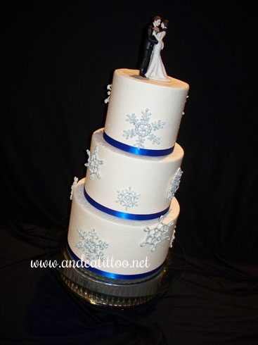 "Last wedding cake of the year! This is a 10"", 8"" and 6"" red velvet cake with cream cheese filling. Vanilla butter cream over all. Snowflakes are made of royal icing. Served 74. Wedding and reception were held at Gervasi Vineyard & Italian Bistro in Canton."