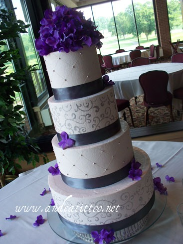 """Chambord & Silver"", 14"" & 8"" are almond cake filled with strawberry. 10"" & 6"" are chocolate rush cake filled with raspberry. Chambord butter cream over all. Served 152. Reception was held at Firestone Country Club in Akron. Real ribbon, silk flowers."