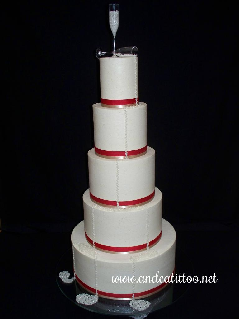 "This is a 14"", 8"" & 6"" almond cake, and a 10"" & 4"" cinnamon cake, all filled & covered with chinese 5 spice butter cream. The ribbons are real, the glasses plastic and the ""champagne"" pearl dragees. Served 160. Reception was held at St. George Social Center in Canton."