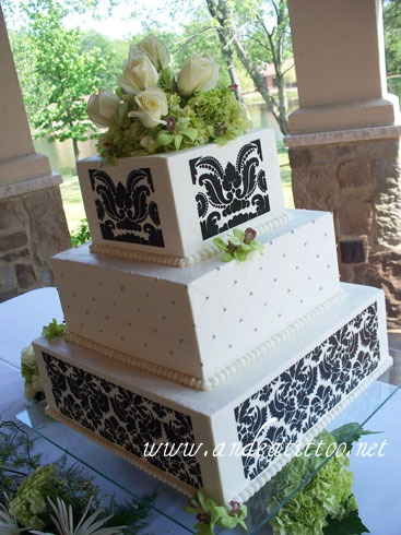 """Damask Quilt"", 16"" & 8"" tiers are cinnamon cake with apple filling. 12"" tier is orange cake with vanilla butter cream filling. Creme de cacao butter cream over all. Served 232. Wedding and reception were held at Gervasi Vineyard in Canton. Flowers are fresh. I went to school with the mother of the bride for 12 years in East Canton."