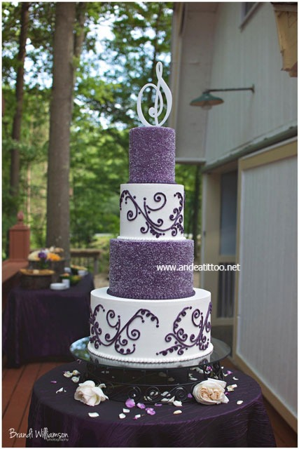 "Jackie's Cake! This is a 12 & 4"" french vanilla cake filled with chocolate bavarian cream, and an 8 & 6"" chocolate rush cake filled with cream cheese. Creme de cacao butter cream over all. Served 138. The purple tiers are covered in sparkling sugar. The topper is plastic, I think they had it made. The wedding and reception were held at Country Cottage & Gardens in Mineral City, Ohio. Photo was taken by Brandi Williamson Photography."