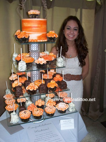 This dessert tower was for my Niece's graduation party. The white chocolate dipped squares are pina colada cheesecake, the chocolate dipped ones are oreo cheesecake. The cupcakes are chocolate and almond cake filled with strawberry, cream cheese or chocolate bavarian cream. Party was held at her home. Served 96