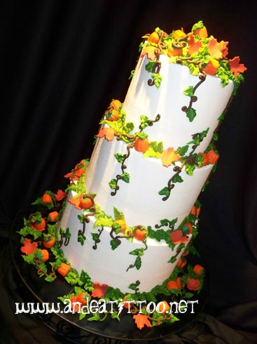 "October Cake, This IS a wedding cake! 10"" is strawberry cake filled with vanilla bavarian. 8"" & 6"" are orange cake filled with lemon filling. Amaretto butter cream over all. The pumpkins are those mallow candies (like candy corn) the leaves are fondant. Served 74. Reception was held at Sippo Lake Clubhouse in Canton."