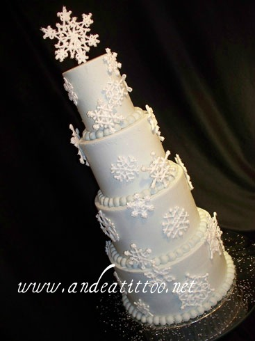 "Snowflakes on ice. 6"" & 10"" were yellow cake filled with chocolate bavarian cream. 8"" & 4"" were strawberry cake filled with cream cheese. Creme de cacao butter cream over all. Snowflakes were made of royal icing sprinkled with sparkling sugar. Served 82. Reception was held at Skyland Pines in Canton."